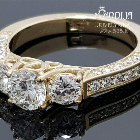 Prabangus moteriškas žiedas su briliantais. Svoris 6g, briliantai 0.63ct, 2vnt po 0.25ct, 32vnt po 0.015ct. Kaina nuo 4000€