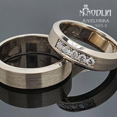 Trapecinės formos vestuviniai žiedai puošti briliantais. Svoris 12g, briliantai po 0.03ct. Kaina 900€